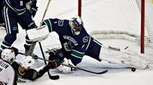 Canucks goalie Roberto Luongo blocks a shot during first-period NHL action in Vancouver on Tuesday. (ANDY CLARK/REUTERS)