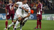 Manchester United's Robin van Persie (C) celebrates his goal against CFR Cluj during their Champions League Group H soccer match in Cluj-Napoca. (BOGDAN CRISTEL/REUTERS)