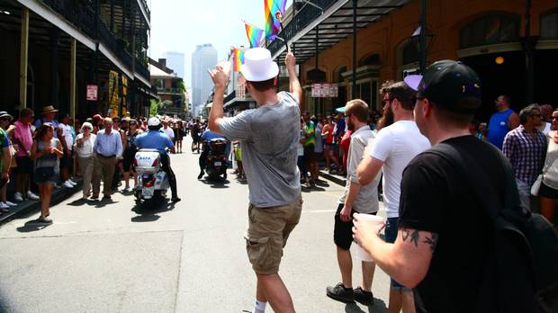 We organized a legal parade on the streets of New Orleans for a bachelor party. Chris, the groom in a top hat, led the way with a plastic baton. Behind us, a five-man brass band announced our presence and a police escort cleared the way.