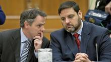 Former Liberal staffer Adam Caroll, right, listens to advice from his lawyer ahead of his testimony before the Commons ethics committee on April 24, 2012, about the Vikileaks Twitter account he created. (Adrian Wyld/Adrian Wyld/The Canadian Press)