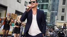 "Robin Thicke performs on NBC's ""Today"" show in New York, July 30, 2013. (Charles Sykes/THE CANADIAN PRESS)"