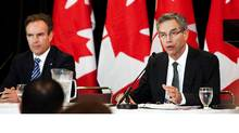 MInister of Natural Resources Joe Oliver, right, and Patrick Lamarre, president and CEO of SNC-Lavalin Nuclear Inc., announce SNC-Lavalin's acquisition of Atomic Energy of Canada Ltd.'s Candu division. (Della Rollins For The Globe and Mail)