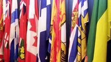A series of provincial flags are seen at a news conference in Ottawa (Tom Hanson/The Canadian Press/Tom Hanson/The Canadian Press)