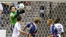 Vancouver Whitecaps goalkeeper Joe Cannon makes a save against the New York Red Bulls during the first half of their MLS soccer match in Vancouver, British Columbia June 20, 2012. (BEN NELMS/REUTERS)