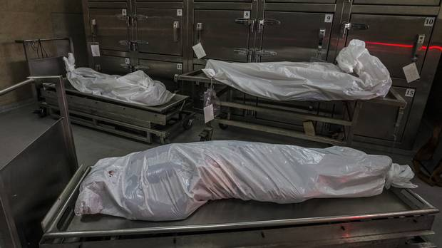 The remains of murder victims in the morgue lay in white plastic bags in San Salvador, El Salvador, May 29, 2015.