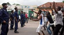 Supporters of the opposition Union for Democracy and Social Progress (UDPS) face police in Kinshasa on December 23, 2011. (GWENN DUBOURTHOUMIEU/AFP/Getty Images/GWENN DUBOURTHOUMIEU/AFP/Getty Images)