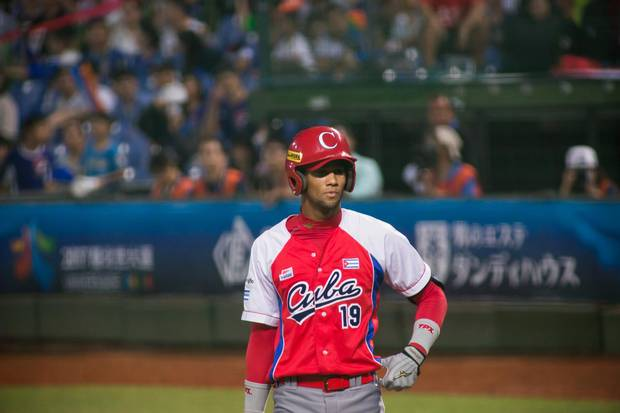LOURDES GURRIEL #19 of Cuba plays the WBSC Premier 12 match between Cuba and Taiwan at the Taichung Intercontinental Baseball Stadium on November 14, 2015 in Taichung, Taiwan. Photographer: