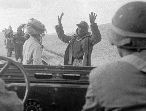 An Egyptian soldier surrenders to an Israeli army patrol in the Sinai Desert on Nov. 1, 1956.
