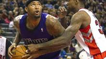 Sacramento Kings' DeMarcus Cousins drives to the basket past Toronto Raptors' Ed Davis (R) in the second half of their NBA basketball game in Toronto January 4, 2013. (FRED THORNHILL/REUTERS)
