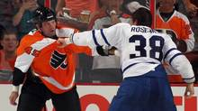 Jay Rosehill #38 of the Toronto Maple Leafs and Jody Shelley #45 of the Philadelphia Flyers wind down in their second period fight at the Wells Fargo Center on September 21, 2011 in Philadelphia, Pennsylvania. (Bruce Bennett/Getty Images)