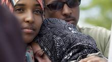 Sister Amal Elmi (left) and brother Liban Elmi (right) after the burial of shooting victim Abdulle Elmi on Sunday, July 8, 2012 in Concord, Ont. The twenty-five-year-old victim, whose body was found in a quiet residential street in Etobicoke Thursday morning, was related to the late Eaton Centre shooting victim Ahmed Hassan. (Michelle Siu/The Globe and Mail)