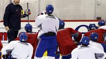 Montreal Canadiens' head coach Michel Therrien (L) talks to the team as they begin their official training camp in Brossard, Quebec January 13, 2013. (CHRISTINNE MUSCHI/REUTERS)