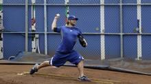 Toronto Blue Jays' pitcher Kyle Drabek throws in the bullpen during spring training baseball, Friday, Feb. 17, 2012, in Dunedin, Fla. (Matt Slocum/Associated Press)