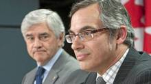 Industry Minister Tony Clement and Foreign Affairs Minister Lawrence Cannon hold a news conference in Ottawa on May 18, 2010. (The Canadian Press)