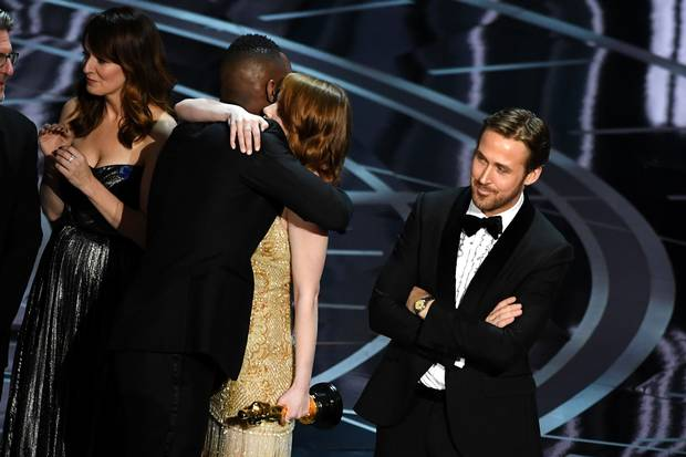 Moonlight actor Mahershala Ali hugs Emma Stone after the award mixup was uncovered.
