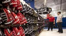A man shops around for hockey equipment while waiting for his skates to be sharpened at a sporting-goods store in Vaughan, Ont. (TIM FRASER FOR THE GLOBE AND MAIL)