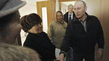 Russian Prime Minister Vladimir Putin visits residents of a damaged nine-storey building, a section of which collapsed after a household gas explosion, in the southern city of Astrakhan Feb. 28, 2012. (RIA Novosti/Reuters/RIA NOVOSTI/Reuters)