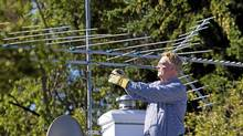 Peter Warner is an electrical engineer in Calgary with four antennas on his roof that pick up all the local stations. 'The images are incredible,' he says (CHRIS BOLIN FOR THE GLOBE AND MAIL)