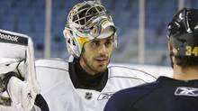 Buffalo Sabres' Ryan Miller talks with Chris Butler (34) during hockey practice in Buffalo, N.Y., Friday, April 16, 2010. The Sabres play the Boston Bruins in Game 2 of a first-round NHL playoff hockey game on Saturday. (AP Photo/David Duprey) (David Duprey)