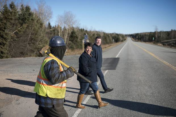 Chief PJ Prosper of Paqtnkek Mi'kmaw Nation, right, crosses the TransCanada in Afton Station, N.S., with Rose Paul, the First Nation's economic development officer, and band member Travis Isadore, left. The small Mi'kmaw community east of Antigonish saw its lands cut in half by a highway in the 1960s, but a new interchange aims to give both sides of the reserve access to the TransCanada.