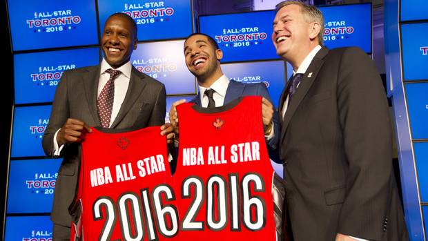 Toronto Raptors general manager Masai Ujiri (L), rapper Drake, and President and CEO of Maple Leaf Sports and Entertainment Tim Leiwekea (R) pose after an announcement that the Toronto Raptors will host the NBA All-Star game in Toronto, September 30, 2013.