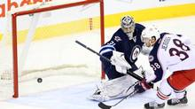 Columbus Blue Jackets forward Boone Jenner (38) scores a penalty shot goal past Winnipeg Jets goalie Ondrej Pavelec (31) during the second period at MTS Centre. (Bruce Fedyck/USA Today Sports)