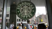 People walk past the Starbucks outlet on 47th and 8th Avenue in New York in this June 29, 2010 file photo. (LILY BOWERS/Lily Bowers/Reuters)