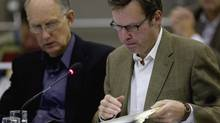 FILE PHOTO: Council for the province of British Columbia Christopher Jones, right, and Martin Gertsma look over their notes as they question members of the Enbridge panel at the Joint Review Panel looking into the Northern Gateway Pipeline in Prince George, B.C. Wednesday, Oct. 10, 2012. (Jonathan Hayward/The Canadian Press)