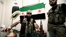In this Tuesday, July 24, 2012 photo, Free Syrian Army soldiers are seen at the border town of Azaz, some 20 miles (32 kilometers) north of Aleppo, Syria. (Turkpix/AP)