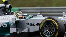 Mercedes Formula One driver Nico Rosberg of Germany drives during the qualification session of the Hungarian F1 Grand Prix at the Hungaroring circuit, near Budapest, July 26. (BERNADETT SZABO/REUTERS)