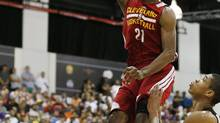 Andrew Wiggins of the Cleveland Cavaliers dunks against the Milwaukee Bucks in an NBA summer league basketball Friday, July 11, 2014, in Las Vegas. (John Locher/AP)