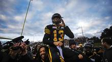 Hamilton quarterback Dan LeFevour and his Tiger-Cats teammates celebrate his game-winning touchdown in overtime in Guelph on Sunday. (MARK BLINCH/REUTERS)