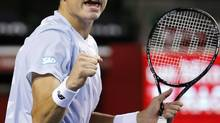 Milos Raonic of Canada reacts after getting a point against Ivan Dodig of Croatia during their semifinal match of the Japan Open Tennis Championships, in Tokyo, Saturday, Oct. 5, 2013. (Koji Sasahara/AP)