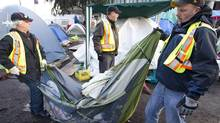 City of Vancouver workers remove an unoccupied tent at the Occupy Vancouver site on the Vancouver Art Gallery grounds Nov. 15, 2011. (John Lehmann/The Globe and Mail/John Lehmann/The Globe and Mail)
