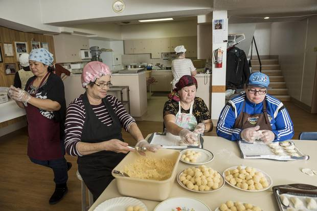 Emma Galang, Elenita Ajusto, Margaret Kluzinski, and Lee-Ann Kluzinski of the Perogy Pinchers work in the basement of St. Gerard Parish.