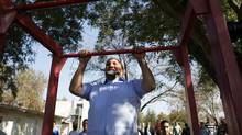 Naftali Bennett head of the far-right Bayit Yehudi party, does chin-ups after talking to students at a pre-army training course as he campaigns in the Shapira Center near the southern city of Ashkelon January 20, 2013. (BAZ RATNER/REUTERS)