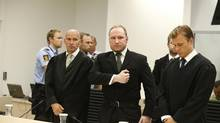 Anders Breivik gestures as he leaves the Oslo courtroom after the the verdict at his trial in August, 2012. Judges declared him sane enough to answer for the killing of 77 people. (NTB SCANPIX/REUTERS)
