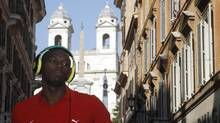 Jamaican sprinter Usain Bolt adjusts his headphones as he performs at a deejay console during a children's race in front of Spain Square in Rome in this May 29, 2012 file photo. (ALESSANDRO BIANCHI/REUTERS)