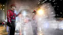 Jason Corlett, a supervisor with the Downtown Ambassadors program, and partner Vanessa Marshall walk their beat on Granville St. in Vancouver Jan. 5, 2011. (JOHN LEHMANN/THE GLOBE AND MAIL/JOHN LEHMANN/THE GLOBE AND MAIL)