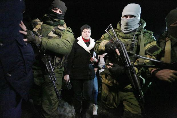 Pro-Russian fighters accompany Nadiya Savchenko, middle, on a visit to the community of Makiivka, Donetsk region, on Feb. 24, 2017.