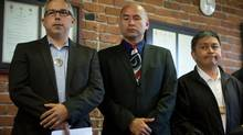 From left, Peter Lantin, president of the Haida First Nation, Ellis Ross, Chief Councillor of the Haisla First Nation and Clarence Innis, acting chief councillor for the Gitxaala First Nation, stand together at aa news conference in Vancouver on Monday. Eight groups challenged the Northern Gateway pipeline on Monday. (DARRYL DYCK FOR THE GLOBE AND MAIL)