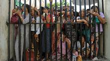 Family members of prisoners wait for their release outside the Insein central prison in Yangon on October 12, 2011. (Soe Than WIN/AFP/Getty Images)/Soe Than WIN/AFP/Getty Images))