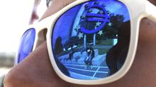 A euro sign is mirrored in sunglasses of a person standing in front of the European Central Bank (ECB) headquarters in Frankfurt. (RALPH ORLOWSKI/RALPH ORLOWSKI/REUTERS)