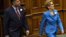 Ontario Finance Minister Charles Sousa enters the legislature next to Premier Kathleen Wynne before delivering the 2014 budget at Queen's Park in Toronto on Thursday, May 1, 2014. (Nathan Denette/THE CANADIAN PRESS)