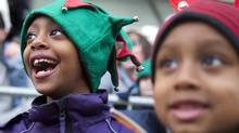 Children watch as Santa rides by on his float during the Santa Claus Parade in Toronto on Sunday November 18, 2012. (Chris Young/The Globe and Mail)