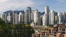 Vancouver's real estate scene; Fairview slopes townhouses under construction (foreground) and high rise condo towers in the city's Yaletown district, May 3, 2013. (Bayne Stanley/The Canadian Press)