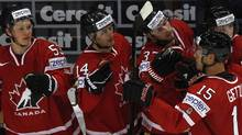 Canada's Jeff Skinner (L to R), Jordan Eberle, Ryan O'Reilly congratulate scorer Ryan Getzlaf during their 2012 IIHF men's ice hockey World Championship game with Switzerland in Helsinki May 9, 2012. (GRIGORY DUKOR/Grigory Dukor/REUTERS)
