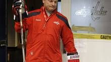 Former Washington Capitals hockey head coach Dale Hunter walks out of the locker room for team practice in Arlington, Va., Monday, Nov. 28, 2011. Hunter will take over as coach of the London Knights according to a report by TSN. ((AP Photo/Pablo Martinez Monsivais))
