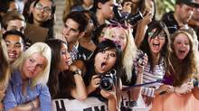 "Fans react to actor Darren Criss (not seen) arriving on the red carpet for the gala presentation of the film ""Imogene"" at the 37th Toronto International Film Festival, September 7, 2012. (MARK BLINCH/REUTERS)"