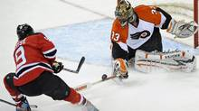 Philadelphia Flyers goaltender Brian Boucher, right, stops a shot by New Jersey Devils' Zach Parise during the first period of an NHL first-round playoff hockey game Thursday, April 22, 2010 in Newark, N.J. (AP Photo/Bill Kostroun) (Bill Kostroun)